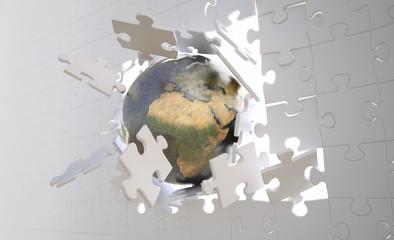 Eaarth breaking through jigsaw wall