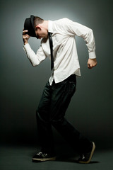Young handsome man in white shirt dancing.