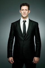 Handsome businessman in black suit.