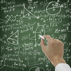 Hand writing maths formula on chalkboard