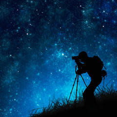 silhouette of photographer shooting stars