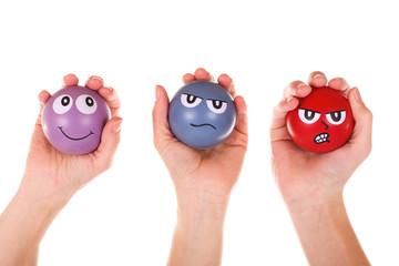 3 Hände mit Stressbällen