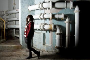 Asian woman in dark area showing sad mood