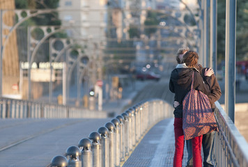 Bridge and pair of lovers on city background