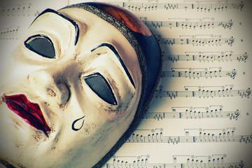 Pierrot mask over written music , retro styled