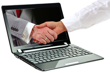 Laptop with business agreement symbol on display