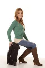 sitting suitcase