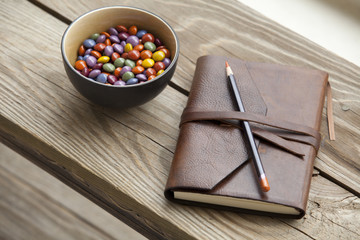 Leather book and candy