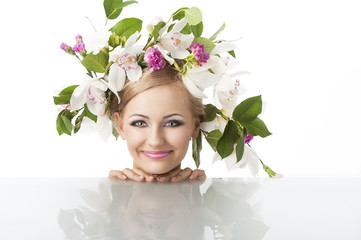 pretty blond with flower crown on head, she looks in to the lens