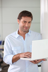 Man with computer in hand