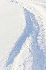 Fototapete - Trace of tire of big car in deep snow