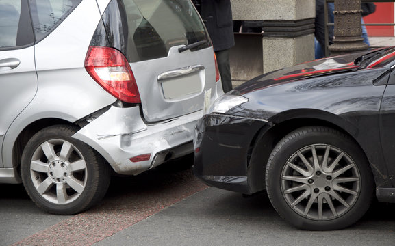 Two cars crash each other