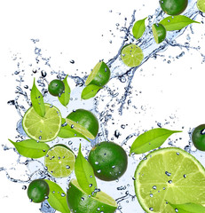 Fotorolgordijn Opspattend water Limes falling in water splash, isolated on white background