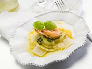 pesto ravioli with shrimp and parmesan flakes