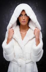 Beautiful woman in white fur coat