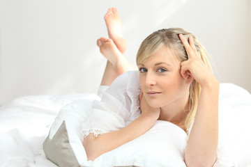 blonde woman at bed