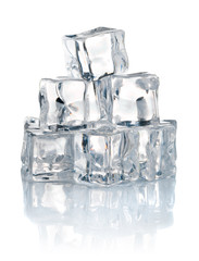 pile of cold ice cubes isolated on white background