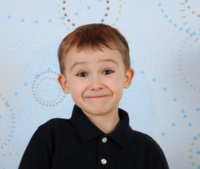closeup of sweet little boy making a cute smile