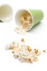 Popcorn in a green paper cup