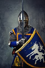 Aluminium Prints Knights Medieval knight on grey background.