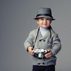 Baby boy with retro camera.