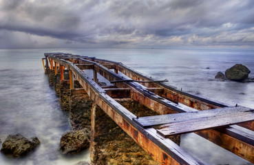 Old rusty pier in a cloudy day