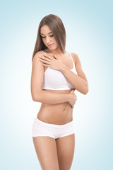 young woman touching her body