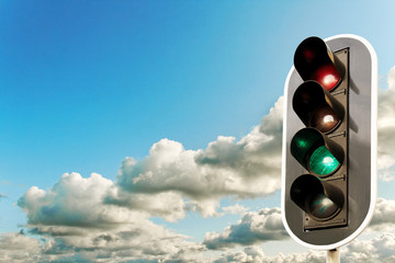Big clouds and traffic light.