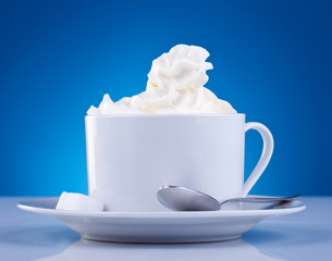 coffee and cream on blue background