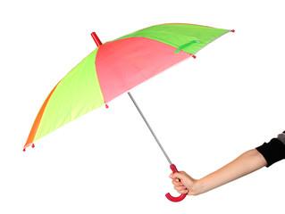 Multi-colored umbrella in hand isolated on white