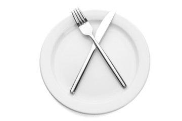 White empty plate with fork and knife isolated on white
