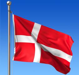 Flag of Denmark against blue sky.
