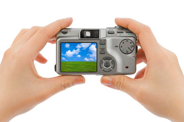 Photo camera in hands and landscape (my photo)