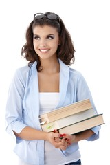 Attractive college student with books