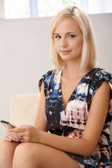 Portrait of blonde with mobile phone