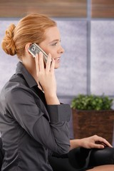 Businesswoman on mobile phone call