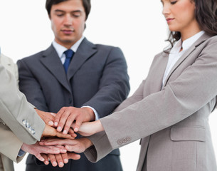 Hands of salespeople together