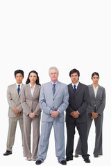 Mature salesman standing together with his team