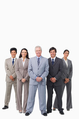Smiling mature salesman standing together with his team