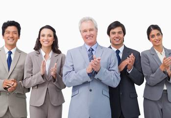 Senior businessman and his team applauding