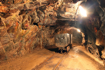 Wall Mural - Underground train in mine, carts in gold, silver and copper mine