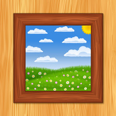 Wooden window and summer green field