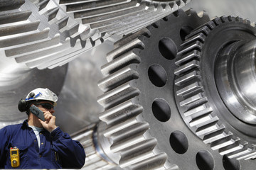 Wall Mural - industrial worker with giant gears machinery