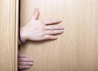 Hand and door.