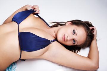 Cute brunette in blue bikini