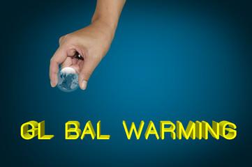 Hand pick earth globe as O on the word Global warming