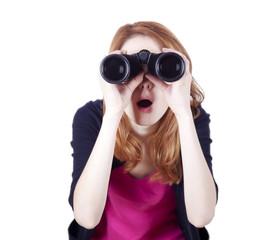 Teen redhead girl with binoculars