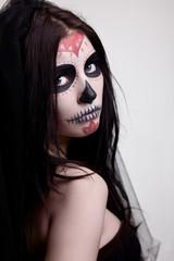 Depressed woman skull face art look at camera