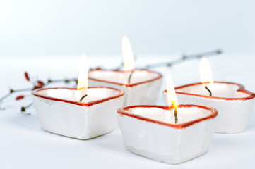 Four heart-shaped candles