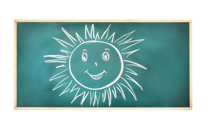 Blackboard with drawing smiling sun isolated on white